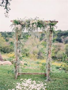 bohemian wedding arbor with daisies arch ideas via magnolia rouge