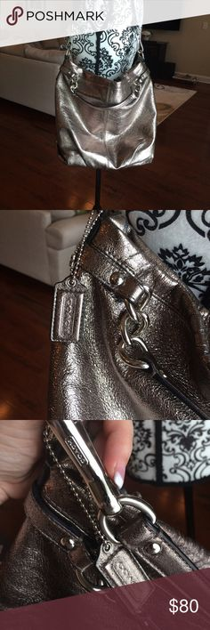 """Coach satchel handbag Coach silver satchel handbag. In well loved condition. Great bag! Has some wear along the top and bottom corners. Hard to see due to the color of the bag. Has lots of use still in it. Bag measures 16"""" across 12 1/2 """" deep and has an 8"""" strap drop. Coach Bags Satchels"""