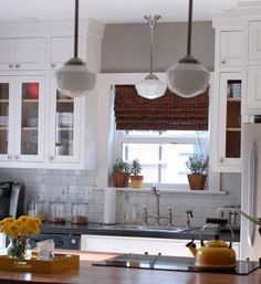 Remove soffit over sink and paint wall color. Adds height, makes window focal point.  Kitchen Makeovers