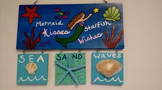 Painted this for a beach themed room using a wooden hanging board from AC Moore and acrylic paints. I hot glued the seashells on and sprayed sealed it with Modge Podge.
