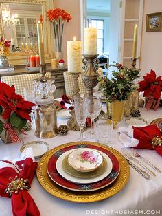 Gilded chargers from Pottery Barn,  tartan dinner plates from Williams Sonoma., crisp white salad plates  & gold appetizer plates from Crate & Barrel, topped  with vintage dessert bowls in the American Beauty pattern from Royal Albert.