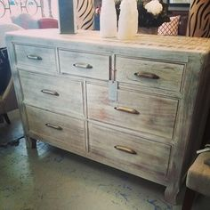 7 Drawer, distressed wood, brass hardware @ Darby Road Home