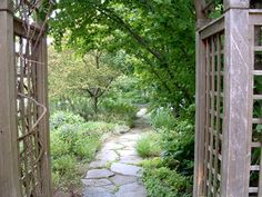 View through the pergola down the stone path. Love this pathway and how it could wander though my Japanese Garden. Garden Paths, Horticulture, Outdoor Dining, Trellis, Garden Inspiration, Landscape Design, Stone Pathways, Gazebo, Sidewalk