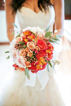 Bride's Bouquet With A Pink/Peach/Coral/Orange Color Palette Featuring Mostly Roses & Spray Roses + Green Seeded Eucalyptus Hand Tied With A White Ribbon ^^^^