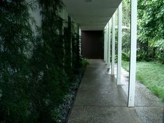 """We you to describe Dorman's design, the word """"reposed"""" comes to mind. In his design for the residence the Sallins would eventually call home, Dorman used a 7 x 9 module throughout, which instills a pleasing dimensional ratio and provided the basis for many of the additions. For example, the original columns in the walkways are spaced seven feet apart and rise to a height of nine feet."""