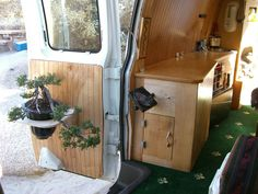 I hate the carpet, but I love the bonsai and the wood interior. A very impressive conversion!