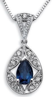 This Unique Vintage Design Cradles a Striking Pear Shaped Sapphire in this Stunning Pendant with Diamond Accents.