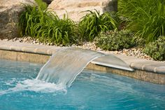 Unusual Waterfall Design for Extraordinary Home Décor Ideas : Adorable Backyard Landscape Ideas With Rectangle Large Swimming Pool Equipped With Pool Waterfall Along With Heavy Green Vegetation Aside