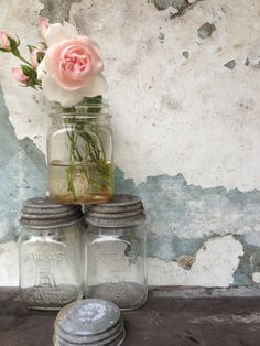 Lovely Vintage Atlas Mason Jars w/ zinc lids...I have some of these...They are wonderful with different collections in them... Vintage Bits and Pieces of Lace, Vintage Thread, Vintage Christmas Light Blubs, Flower Seeds, just to name a few <3