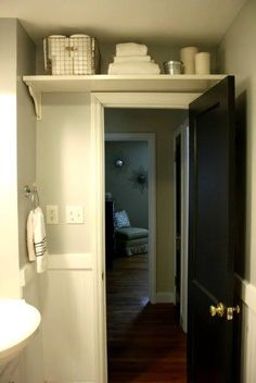 Storage shelf for bathroom over door. Very smart for out of the way items and small bathrooms.