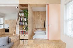 This unusual project was a remodel of a 75-square-meter apartment in the center of Melbourne. The goal was to maximize sleeping areas for the occupants without giving up too much of the living spac...