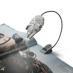For fans of reading and Star Wars. It was a natural progression to make a Millennium Falcon Book Light by which one can read one's favorite Expanded Universe Star Wars Legends novels or reference books.