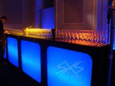 Custom glowing bar units in blue. www.sxsevents.co.uk