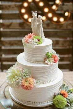 white cake with orange and green @weddingchicks