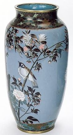 CLOISONNE ENAMEL VASE, the deep blue field having multiple song birds, butterfly and colorful floral motif.