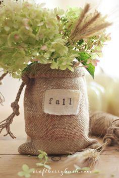 put flowers in mason jar; slip jar into burlap bag ~ Keeping it Simple - Craftberry Bush