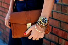 brown envelope clutch, Michael Kors gold watch, gold bracelets, red nails...OBSESSED.