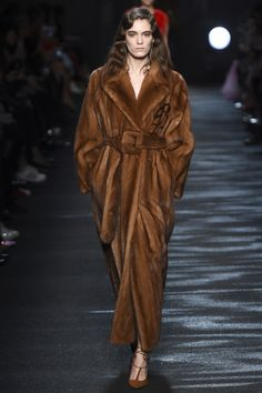 What struck a cord at the Bluemarine Fall 2016 show was the wash of Spring color tones on silhouettes made for Autumn. An eau de nil, long fur coat opened the show, styled with a candyfloss pink mi...