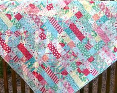 This baby quilt was made with the Sweet fabric line by Urban Chiks for Moda was designed with a citrus flavor and a retro undertone. Inspired by vintage feed sacks and re-imagined in a rainbow of candy colored hues, with a collection of roses, paisleys, stripes and dots. I used one jelly