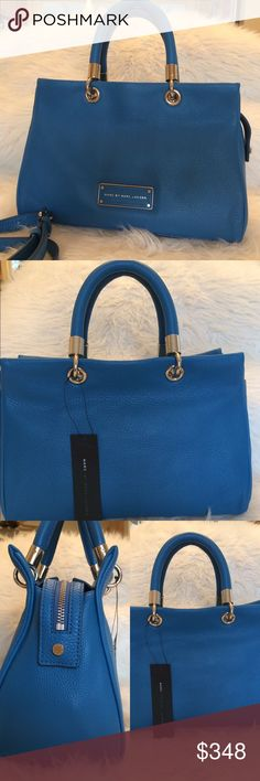 """Host Pick! Marc by Marc Jacobs Leather Satchel Stunning Marc Jacobs satchel in a cerulean blue. Shoulder strap (18-26"""" drop) included. Soft, buttery leather. Silver hardware. Bag is 11""""Hx15""""Lx5""""D. Approx 7"""" handle drop. Top zip closure, fabric lining with one interior slip pocket. Pics do not even do this bag justice. Retail $488. Authentication cards included. This item cannot be bundled. Thanks for looking! Marc by Marc Jacobs Bags Satchels"""