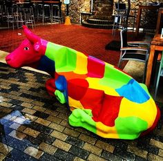 """The famous RD Cheesery """"Miss Cow"""" bench is one of the many photo-op spot at A must see when visiting the Renaissance Mall. Renaissance, Mall, Caribbean, Cow, Dinosaur Stuffed Animal, Bench, Explore, Outdoor Decor, Animals"""