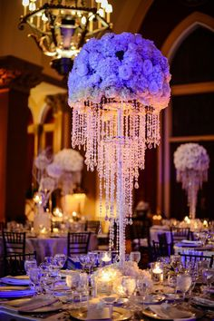 Gorgeous #centerpieces at this #orange and #purple #uplighting #wedding #reception ! #diy #unique #weddingideas #weddinginspiration #ideas #inspiration #rentmywedding #celebration #party By #DominoArtsPhoto in #Florida Wedding Reception Centerpieces, Reception Decorations, Table Centerpieces, Event Decor, Wedding Table, Bling Wedding Decorations, Uplighting Wedding, Centerpiece Ideas, Table Decorations