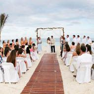destination weddings - well that walkway might be nice...no sinking in the sand on your way down the isle.