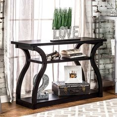 Adding this black console table from Furniture of America to your home or office heightens the modern flair of your space. The curvy lines of this rectangular console table is sure to catch the eye, a