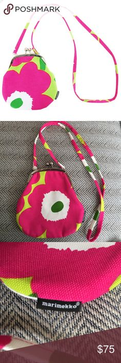 Marimekko Unikko Ababa canvas bag With its slim lines and shoulder strap, the Rimmi bag carries all your important little goodies from one outfit to the next. Brand new, zero flaws. Great price little bag! Marimekko Bags Mini Bags