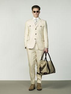 Cream Linen Safari Jacket and Trousers, with White Textured Cotton Shirt and Tan Silk Tie.