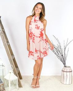 Our Always Yours Dress will be a favorite, truly! A blush hued base accented with beautiful red florals throughout. The lightweight and flirty fit lends to a ro