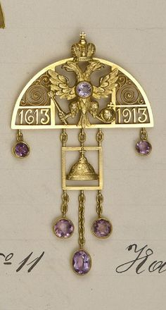 Carl Fabergé - An Imperial Tercentenary Pendant, circa 1913. A gold and amethyst pendant made from the designs of the Empress Alexandra Feodorovna to celebrate the Romanov Tercentenary of 1913. Workshop of Albert Holmström, St. Petersburg, 1913. #Faberge #antique