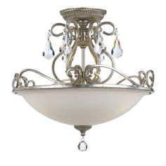 This Ashton Collection 3-light flush mount features an olde silver finish that will complement many transitional decors. The hand cut crystal accents add interest while the frosted glass shade softens the light to complete the look of this piece.