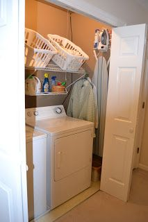 Laundry Closet .. slat rack to hold baskets for sorting