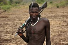 https://flic.kr/p/6b7opC | Nyangatom man with his gun and special scarification, which means he has killed a lot of enemies | The land of the Nyangatom is traditionally around Mount Naita, so they live just north of the disputed Ilemi triangle, currently held by Kenya in both South Sudan and Ethiopia. They are neighbours to the Toposa, who are their friends, but also to the Turkana, their enemies. The Nyangatom pictured here are from a southern group close to and in Ilemi, and even though…