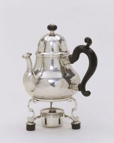 """1705-1706 British Teapot with stand at the Victoria and Albert Museum, London - From the curators' comments: """"Pear-shaped teapots were a standard feature of English silver from the late 17th century, and remained the dominant form until the late 1720s. They are generally quite plain, which makes the applied leaves on the domed cover of this example quite unusual."""""""
