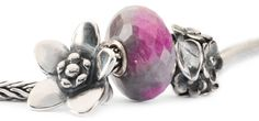A perfect trio for Mother's Day: the Ruby Rock Bead, the Messenger Bead, and the Mom's Bouquet bead: https://www.luanders.com/trollbeads_s/1933.htm