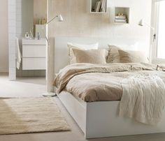 A neutral bedroom with natural materials