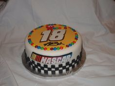 Kyle Busch Nascar Cake- I guess M & M's are fun to put on cakes.  Like the ideaq of this different driver