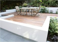 low wall to edge off the deck, instead of a boring railing