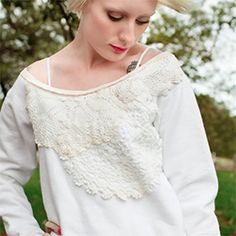 Put some lace on a sweatshirt and make it more fashionable in a few simple steps.