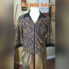 """Olive Green & Black Collar Blouse Step on the Wild Side with the unique olive,black, and cream zipper front blouse. This can be worn as a blouse or jacket just right for a spring or summer day sleeve are  3 quarter length 18 1/2"""" long from shoulder to blouse bottom 22 1/2"""" long. Solid black collar and sleeve cuff. The fabric is a chic lace shown in pic #4. Notations Tops Blouses"""