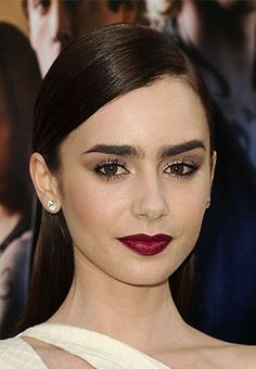 Lily Collins deep burgundy lipstick, bold brows