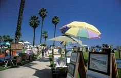 Santa Barbara - Sidewalk art and crafts walk after sunday breakfast.  This is still held out at the beach!