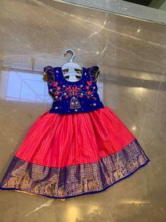 Stunning pink pattu kids lehenga and blue color parikini with bird and cage design hand embroidery thread work on yoke. Age : 1 to 2yPrice : 4500 INR 18 February 2019