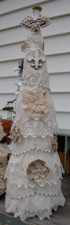 Use flawed/damaged vintage linens and lace for a handmade Christmas Tree!! So going to try this next Christmas!