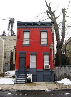 Our red house needs painting.  Love the two tones of grey trim on this house.