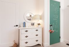 Use chalkboard paint to create a place in your child's room where they can draw and have some fun!