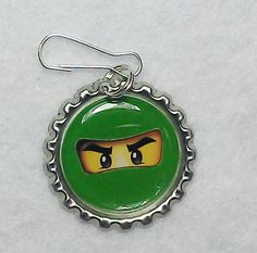Lego Birthday Party Favors - Necklace or Zipper Pull set of 10  bottle cap jewelry - New Gold Ninja. $11.99, via Etsy.