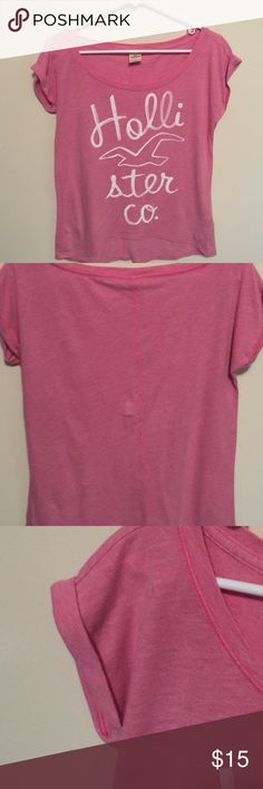 Hollister scoop neck T Shirt Pink Hollister scoop neck T Shirt with cuff sleeves. Tag say XS but is more like a medium. Very loose fit for XS. Smoke free home. Hollister Tops Tees - Short Sleeve